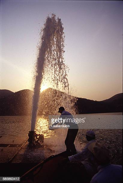 American Professor George Kling along with Cameroonian and Japanese scientific colleagues collects samples from the gaseous carbon dioxide fountain...