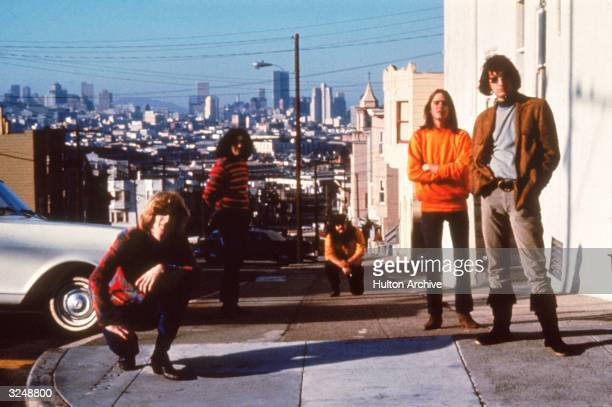 American psychedelic rock band The Grateful Dead pose on the corner of 20th and Connecticut in Potrero Hill San Francisco California circa 1965 Left...