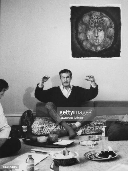 American psychologist Dr Timothy Leary sits on a lowcouch and gestures with his arms as he answers questions from a Life magazine reporter Los...