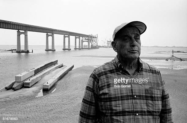 American public official and city planner Robert Moses at a construction site for a Long Island highway bridge probably the Captree State Parkway...