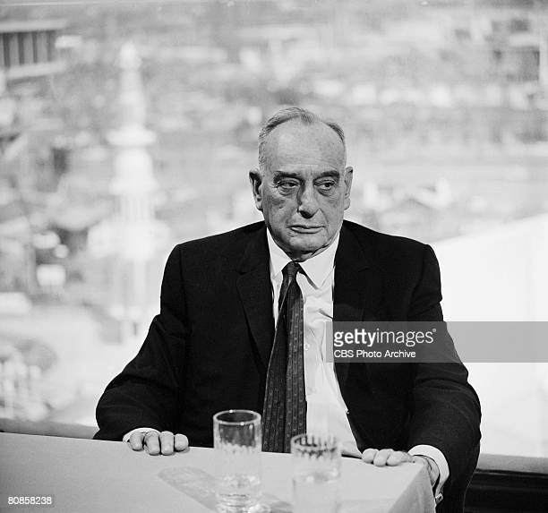 American public official and city planner Robert Moses sits at a table at the 1964/1965 New York World's Fair site on an episode of the television...