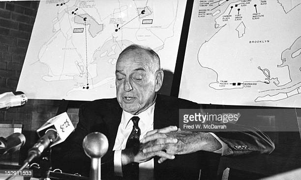 American public official city planner and Director of the Triborough Bridge and Tunnel Authority Robert Moses answers questions at a press conference...