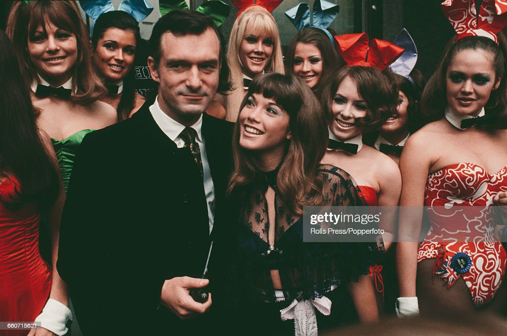 American publisher and club owner, Hugh Hefner pictured with his girlfriend Barbi Benton and various bunny girls during a visit to his London Playboy Club in Park Lane on 5th September 1969.