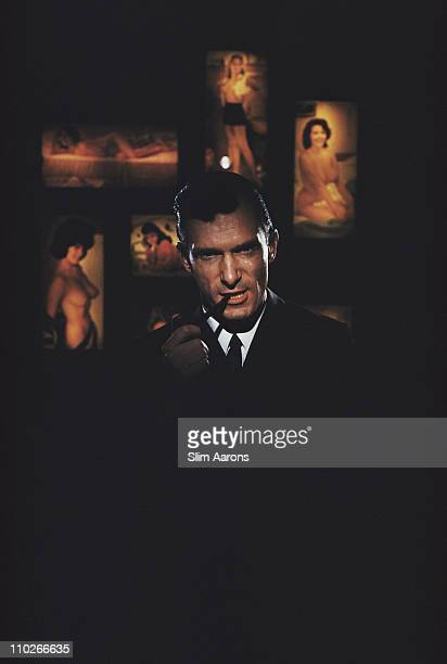 American publisher Hugh Hefner founder of 'Playboy' magazine surrounded by erotica at the Playboy Club in Chicago 1961