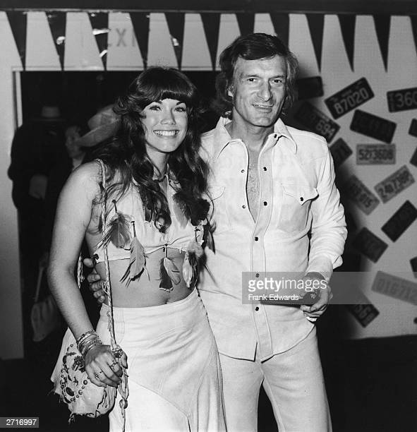 American publisher Hugh Hefner of Playboy Enterprises smiles with his girlfriend American actor and model Barbi Benton as they attend the 21st annual...