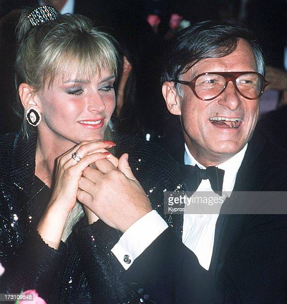 American publisher Hugh Hefner with his wife Kimberley Conrad circa 1990