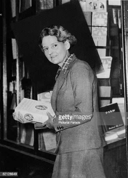 American publisher Sylvia Beach poses for a portrait in her bookshop Shakespeare Company at 8 rue Dupuytren Paris France 1930s Famous for being run...