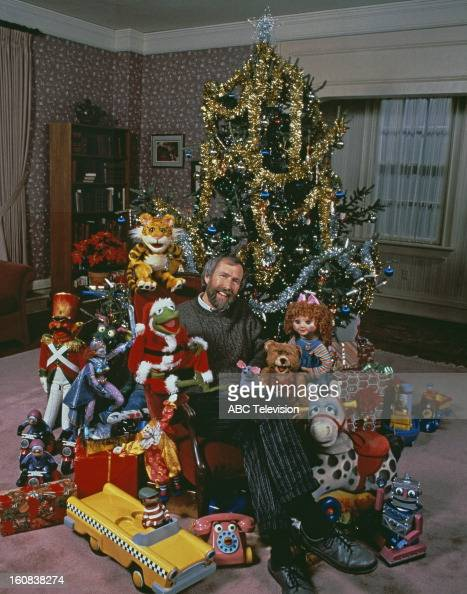 American puppeteer and filmmaker Jim Henson with muppet characters from the ABC TV movie 'The Christmas Toy' directed by Eric Till 1986 Sitting next...