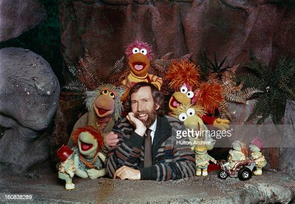American puppeteer and filmmaker Jim Henson with some of the Muppet cast from the children's TV show 'Fraggle Rock' circa 1985 Along with the...