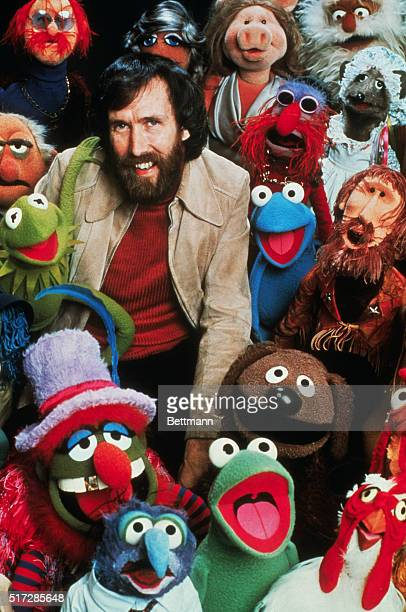 American puppeteer creator of the Muppets and motion pictures Jim Henson poses with his creation characters in The Muppets TV show