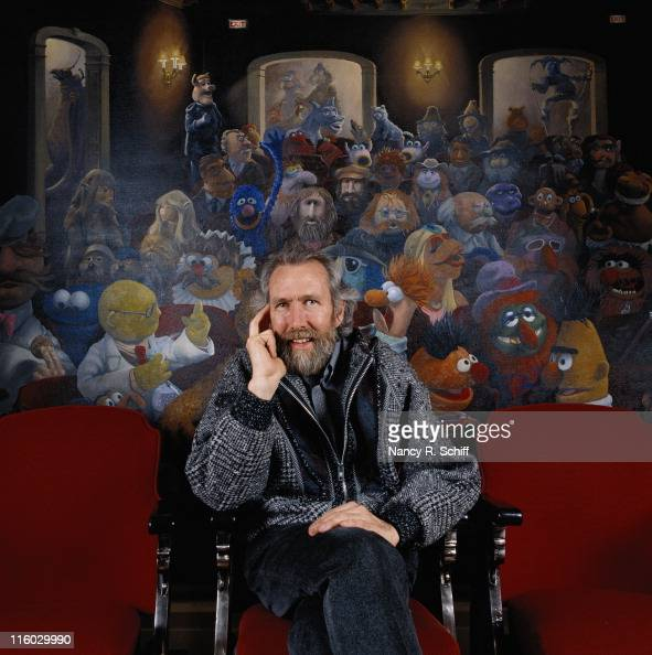 American puppeteer Jim Henson creator of 'The Muppets' with a muppet mural behind him 1986