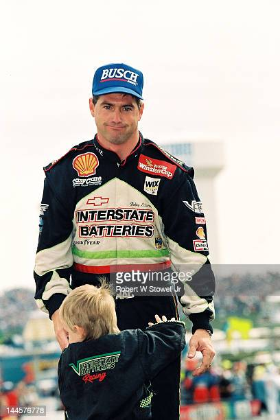 American race car driver Bobby LaBonte and a child at the Winston Cup Race at the Charlotte Motor Speedway Charlotte North Carolina 1997