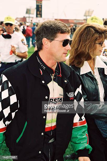 American race car driver Bobby LaBonte walks toward the track at the Winston Cup Race at the Charlotte Motor Speedway Charlotte North Carolina 1997