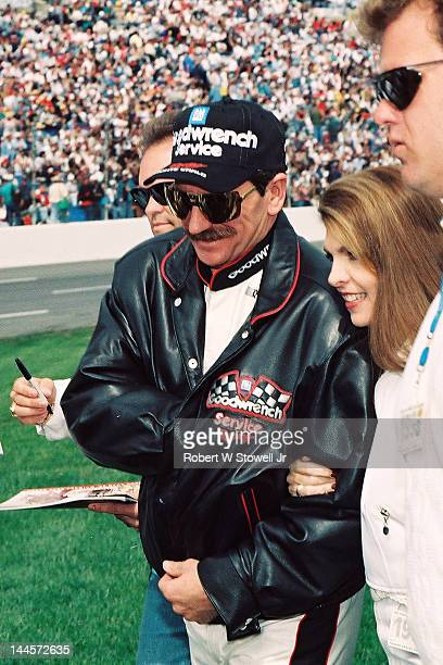 American race car driver Dale Earnhardt walks on the grass before the Winston Cup Race at the Charlotte Motor Speedway Charlotte North Carolina 1997