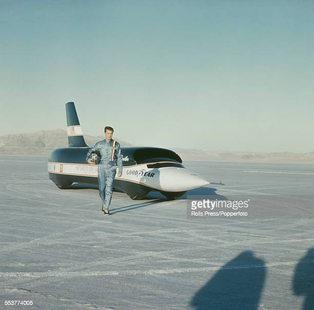 American racing driver and land speed record holder Craig Breedlove stands in front of his car Spirit of America Sonic 1 before setting a new world...