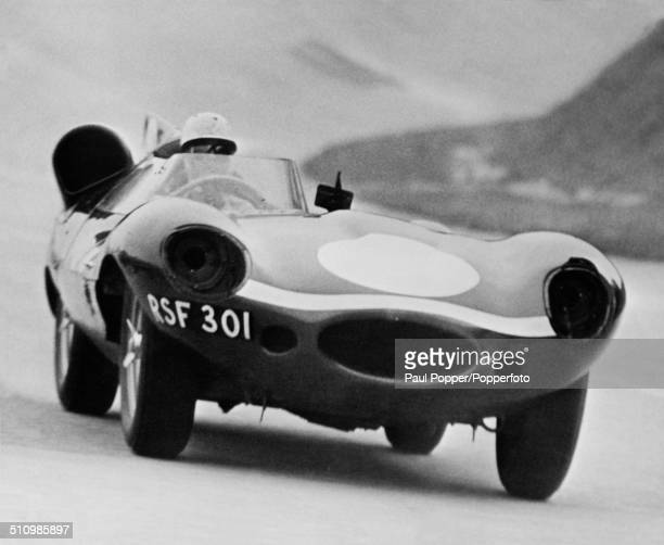 American racing driver Masten Gregory at the wheel of an Ecurie Ecosse Jaguar DType during practice for the Race of Two Worlds at the Autodromo...