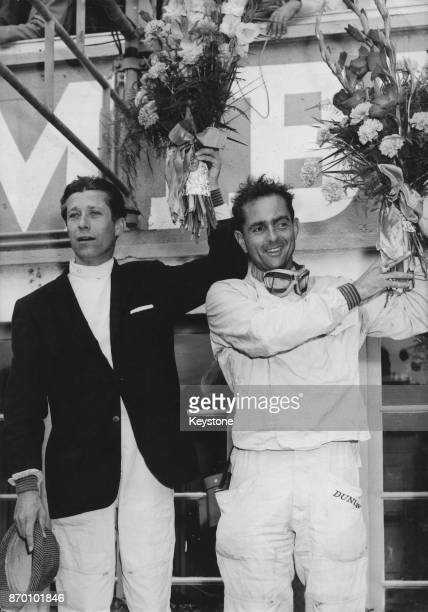 American racing driver Phil Hill and teammate Olivier Gendebien after their victory in the 24 Hours Of Le Mans race France 11th June 1961