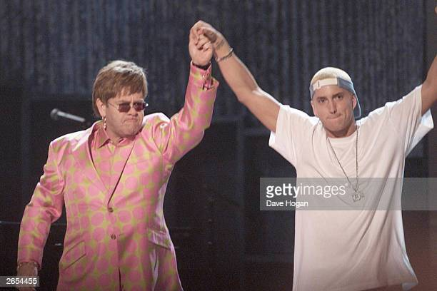 American rap star Eminem and British musician Sir Elton John perform on stage at the 43rd annual Grammy Awards on January 27 2001 in Los Angeles...