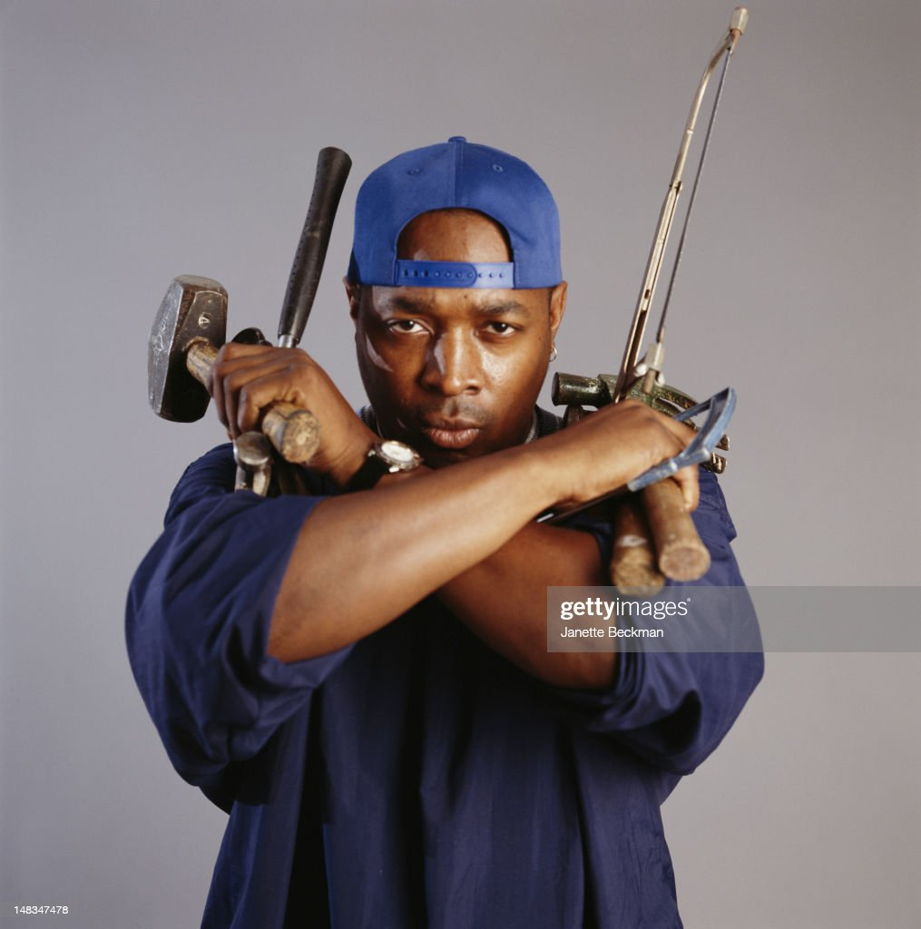American rapper Chuck D with an armful of tools, New York City, 2010.