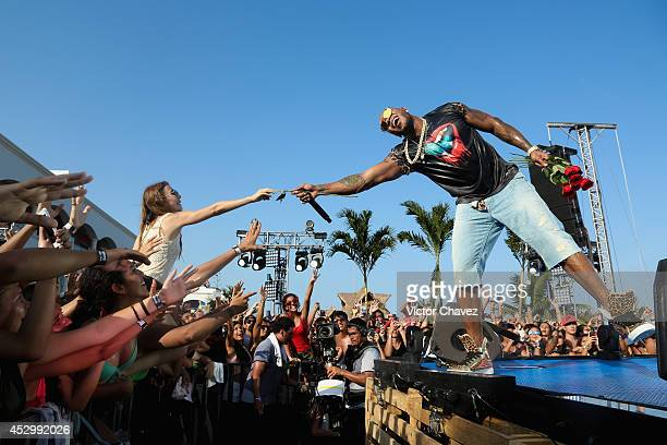 American rapper Flo Rida performs on stage during the MTV World Stage 2014 at Hard Rock Hotel Riviera Maya on July 31 2014 in Cancun Mexico