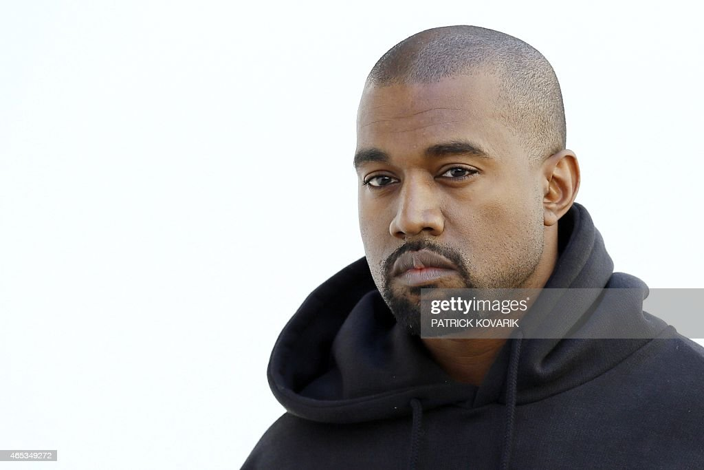 American rapper Kanye West poses before Christian Dior 20152016 fall/winter readytowear collection fashion show on March 6 2015 in Paris AFP PHOTO /...