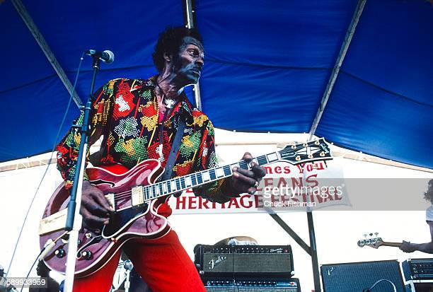 American RB and Rock musician Chuck Berry performs onstage at the New Orleans Jazz Heritage Festival May 1981