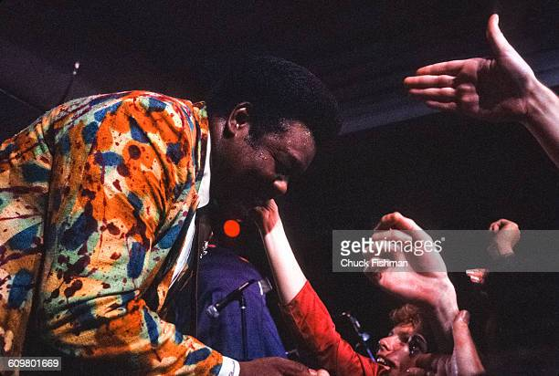 American RB musician Fats Domino shakes hands with his fans after his performance during the New Orleans Jazz Heritage Festival at the Fair Grounds...