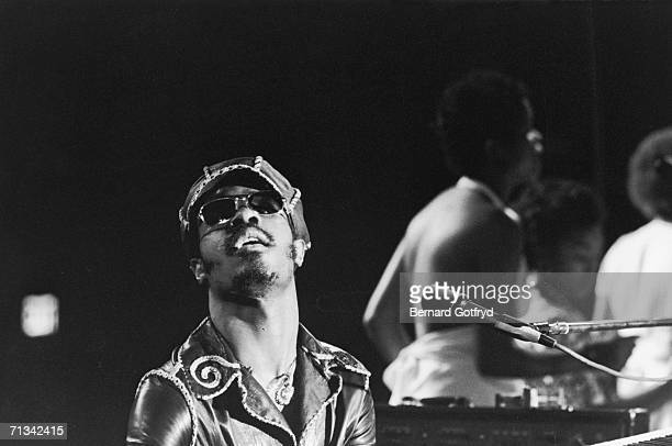 American RB musician Stevie Wonder sits at the piano during a concert 1970s