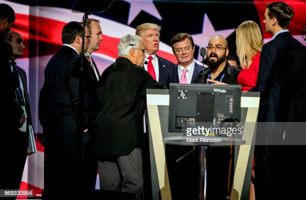 American real estate developer and presidential candidate Donald Trump and others on stage during the sound check on the final day of the Republican...