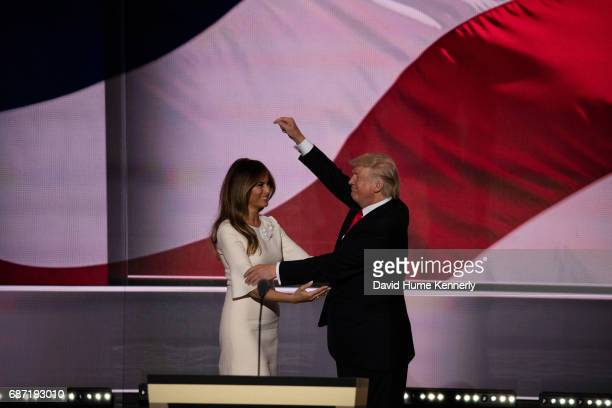 American real estate developer and presidential candidate Donald Trump is joined on stage by his wife former model Melania Trump during the...