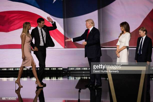 American real estate developer and presidential candidate Donald Trump greets family members on stage during the Republican National Convention at...
