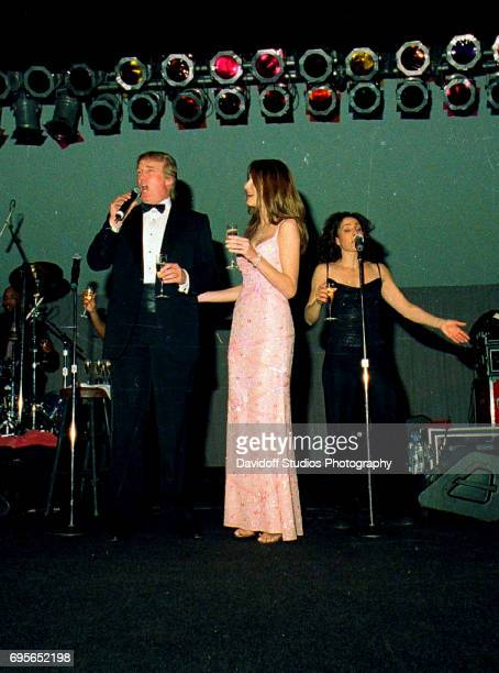 American real estate developer Donald Trump and his wife former model Melania Trump onstage during a New Year's event at the MaraLago club Palm Beach...
