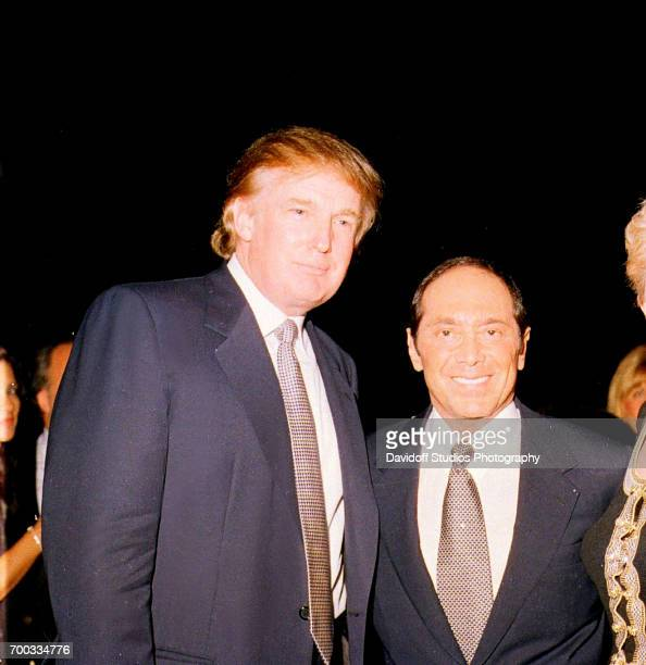 American real estate developer Donald Trump and musician Paul Anka pose together at the MaraLago club Palm Beach Florida January 22 2000