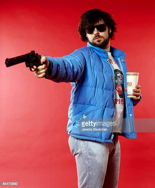 American record producer and hiphop pioneer Rick Rubin poses with a gun and a Blimpie beverage New York 1985