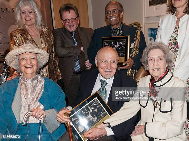 American record producer George Avakian and musician Jimmy Heath pose with others at the ASCAP Jazz Wall of Fame Induction Ceremony in the ASCAP...