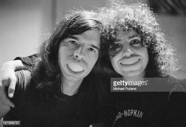 American record producer Tony Visconti and Singer Marc Bolan of British glam rock group TRex smiling with orange peel in their mouths at the Chateau...