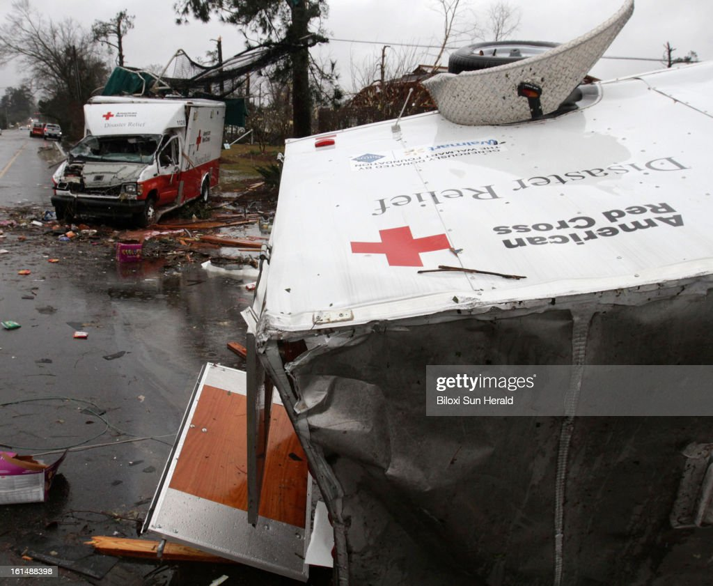 American Red Cross disaster relief vehicles that were damaged in a tornado on Sunday, February 10, 2013, sit on the edge of Hutchinson Avenue in Hattiesburg, Mississippi. An EF-4 tornado hit the area according to a preliminary report from the National Weather Service in Jackson. Sixty-three people were injured in the storm.