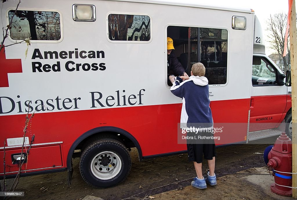 American Red Cross feeds people on November 16, 2012 in Union Beach, New Jersey. Hurricane Sandy devastated this tiny waterfront home on October 29. Residents were allowed back in 3 days ago to see the damage the superstorm caused their houses.
