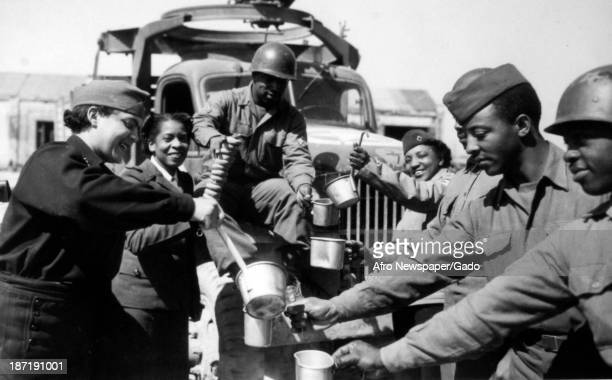 American Red Cross workers distribute food to African American soldiers 1945