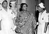American Red Cross workers speak with an African woman in traditional dress 1960
