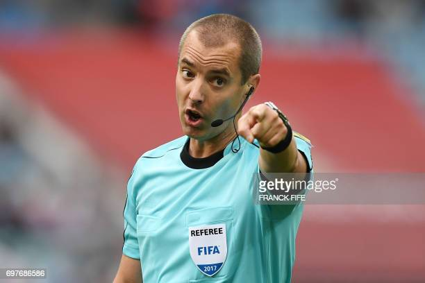 TOPSHOT American referee Mark Geiger reacts during the 2017 Confederations Cup group B football match between Australia and Germany at the Fisht...