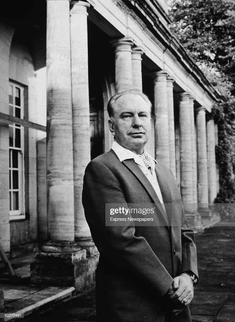 American religious leader and science fiction novelist L Ron Hubbard founder of the controversial Church of Scientology stands outside his home Saint...