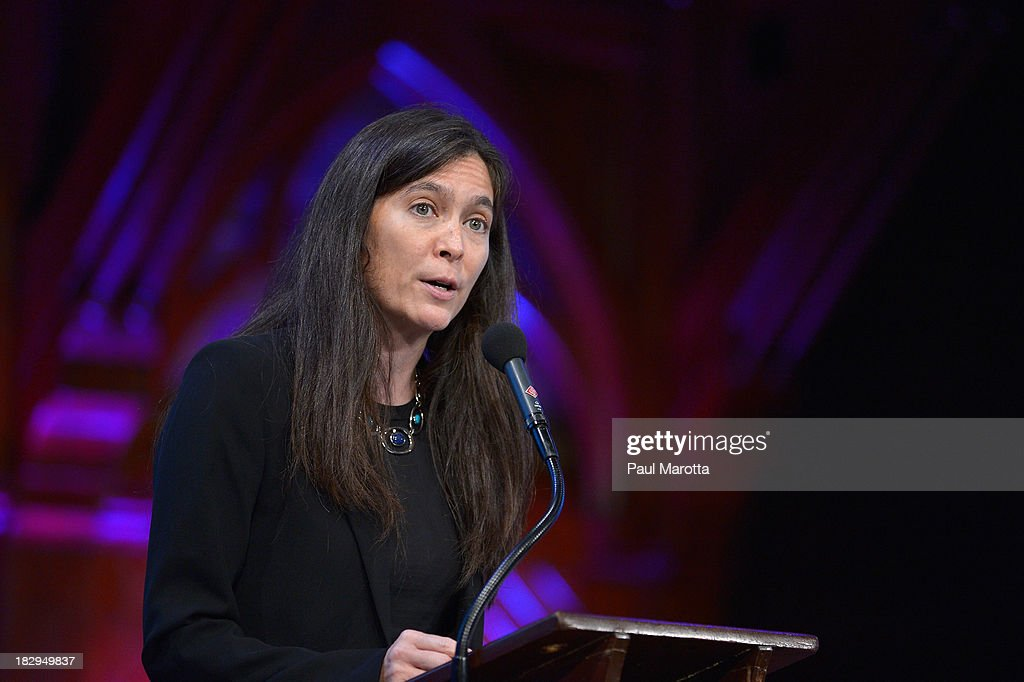 American Repertory Theatre Artistic Director Diane Paulus presents the 2013 W.E.B. Du Bois Medal to Tony Kushner at a ceremony at Harvard University's Sanders Theatre on October 2, 2013 in Cambridge, Massachusetts.