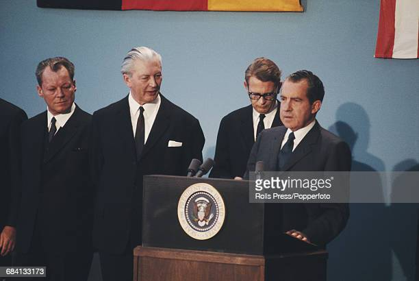 American Republican politician and 37th President of the United States Richard Nixon pictured with West German Chanceller Kurt Georg Kiesinger and...