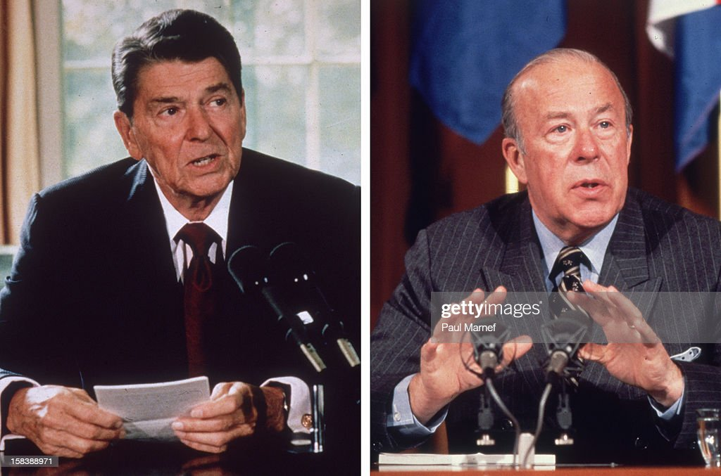 In this composite image a comparison has been made between former US President <a gi-track='captionPersonalityLinkClicked' href=/galleries/search?phrase=Ronald+Reagan+-+US+President&family=editorial&specificpeople=69998 ng-click='$event.stopPropagation()'>Ronald Reagan</a> and his serving Secretary of State George Shultz. UNSPECIFIED - circa 1980: American Republican politician George Shultz at a meeting of NATO in 1980. He served in both the Nixon and Reagan administrations and is credited with shifting American foreign policy towards the Soviet Union towards detente.