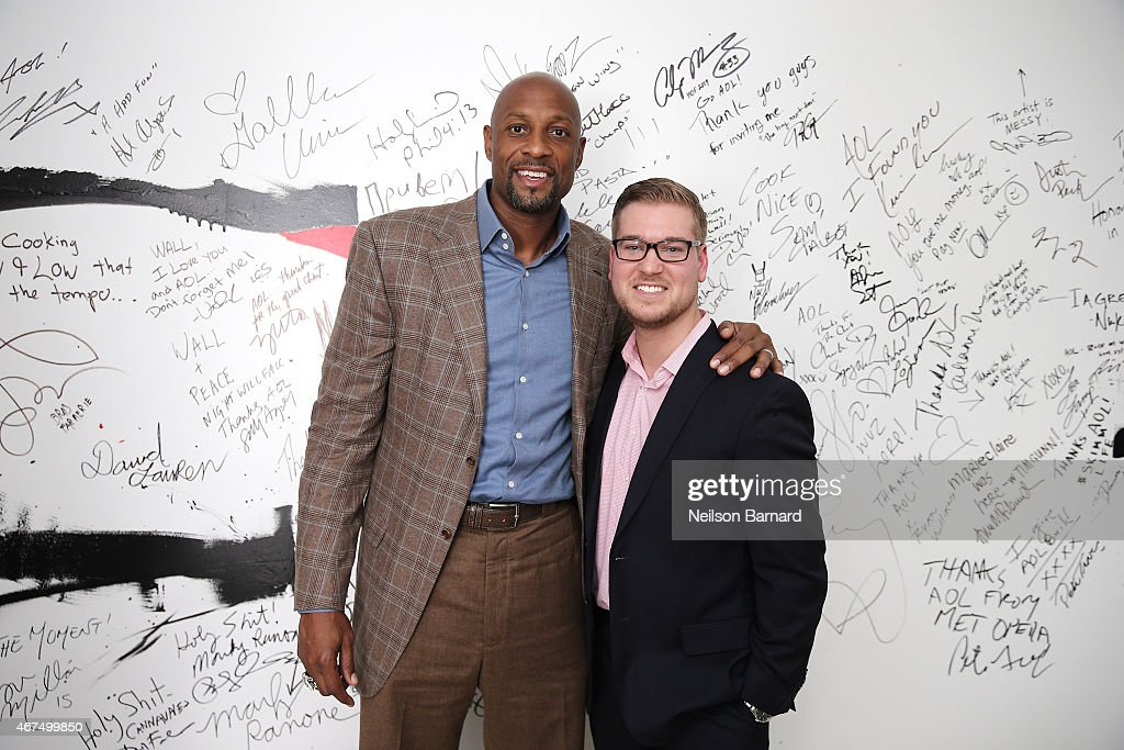 American retired professional basketball player Alonzo Mourning (L) and Brian Fitzsimmons, Senior Sports Editor AOL, discuss March Madness at AOL Studios in New York on March 25, 2015 in New York City.