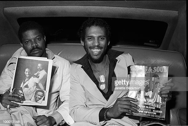 American rhythm and blues musicians Gene McFadden and John Whitehead together known as McFadden Whitehead sit in the back of a car and hold up the...