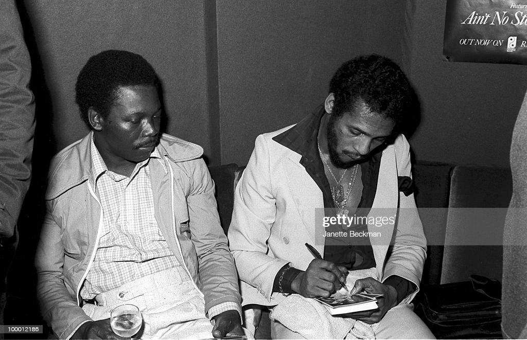 American rhythm and blues musicians Gene McFadden (1948 - 2006) (left) and John Whitehead (1949 - 2004), together known as McFadden & Whitehead, sign autographs, England, mid 1979.