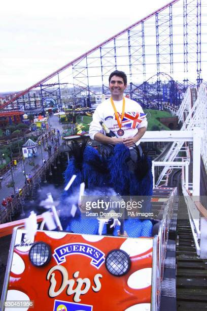 American Richard Rodriguez a teacher from New York at Blackpool Pleasure Beach where he celebrated breaking another world record after riding the Big...