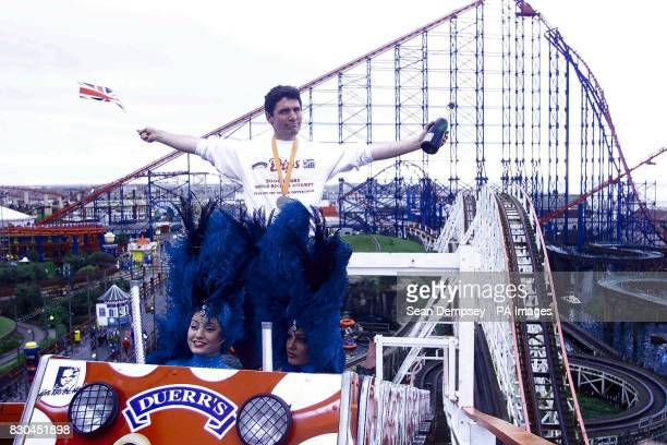 American Richard Rodriguez a teacher from New York at Blackpool Pleasure Beach celebrated breaking another world record after riding the Big Dipper...